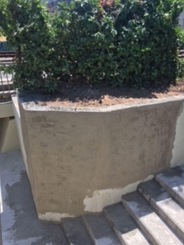 Regularización del muro con revoco de mortero